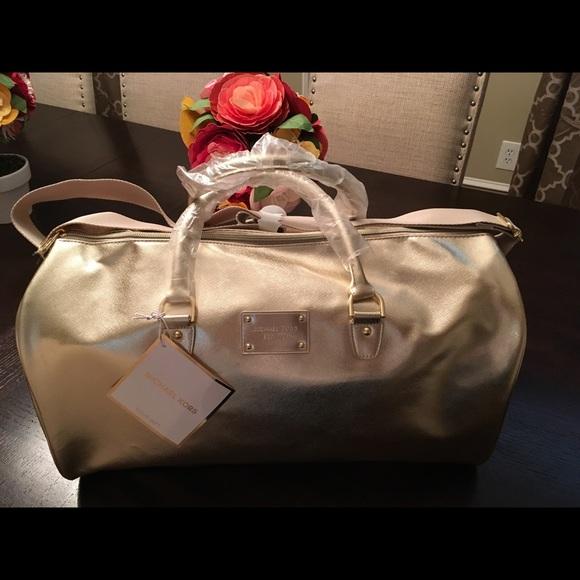eed44c11f0 NEW Michael Kors Metallic Gold Duffle Bag Tote